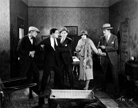 0623720 © Granger - Historical Picture ArchiveTHE TRUNK MYSTERY, 1926.   American silent film. A scene of accusation from 'The Trunk Mystery' from  Pathé Exchange and directed by Frank Hall Crane. Film still, 1926.