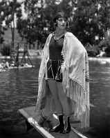 0623757 © Granger - Historical Picture ArchiveSHIRLEY MASON (1900-1979).   American silent film actress. The First National star poses for a beach shawl advertsiement. Photograph by James N. Doolitle, c1920.