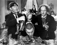 0035051 © Granger - Historical Picture ArchiveTHREE STOOGES: FILM STILL.  Film still of the 'Three Stooges.' Moe Howard (Left), Curly Howard (middle) and Larry Fine (right). American comedians.