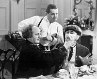 0035052 © Granger - Historical Picture ArchiveTHREE STOOGES: FILM STILL.  Film still of the 'Three Stooges.' Larry Fine (Left), Curly Howard (middle) and Moe Howard (right). American comedians.