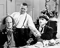 0043830 © Granger - Historical Picture ArchiveTHREE STOOGES: FILM STILL.   Film still of the 'Three Stooges'. Larry Fine (Left), Curly Howard (middle) and Moe Howard (right). American comedians.