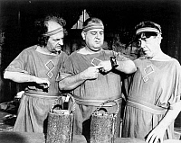0043833 © Granger - Historical Picture ArchiveTHREE STOOGES: FILM STILL.  Film still of the 'The Three Stooges.' Larry Fine (Left), Curly Howard (middle) and Moe Howard (right). American comedians.