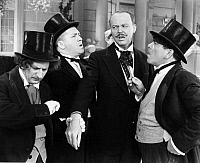 0064120 © Granger - Historical Picture ArchiveTHREE STOOGES: FILM STILL.  Film still of the 'The Three Stooges'. Larry Fine (Left), Curly Howard (middle) and Moe Howard (right). American comedians.