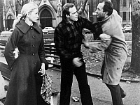 0054852 © Granger - Historical Picture ArchiveON THE WATERFRONT, 1954.   Edie Doyle (Eve Marie Saint) watches Terry Malloy (Marlon Brando) handle a panhandler in a scene from the film.