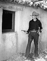 0057208 © Granger - Historical Picture ArchiveMY DARLING CLEMENTINE   Henry Fonda as Wyatt Earp during the gunfight at the O.K. Corral, 1946.