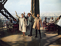 0121704 © Granger - Historical Picture ArchiveFILM: FUNNY FACE, 1957.   From left: Kay Thompson, Fred Astaire and Audrey Hepburn on the Eiffel Tower in Paris in a scene from 'Funny Face,' 1957.
