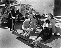 0122448 © Granger - Historical Picture ArchiveFILM: NOTORIOUS, 1946.   The diretor Alfred Hitchcock taking his stars, Cary Grant and Ingrid Bergman, for a ride during the filming of 'Notorious,' 1946.
