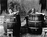 0122894 © Granger - Historical Picture ArchiveTHERE WAS A CROOKED MAN.   Kirk Douglas, left, as a criminal, and Henry Fonda as a Western prison warden, enjoying a bath in the film 'There Was a Crooked Man' directed by Joseph L. Mankewicz, 1970.