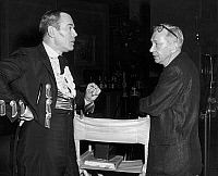 0125678 © Granger - Historical Picture ArchiveFONDA AND DMYTRYK, c1960.   American actor Henry Fonda (left) in conversation with director Edward Dmytryk, on the set of a film, c1960.