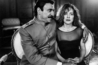 0170238 © Granger - Historical Picture ArchiveCHILDREN OF THE REVOLUTION.   F. Murray Abraham as Joseph Stalin and Judy Davis as Joan in the Australian film, 'Children of the Revolution,' directed by Peter Duncan, 1996.