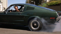 0433238 © Granger - Historical Picture ArchiveFILM: BULLITT, 1968.  Steve McQueen driving a Ford Mustang Fastback GT 390 in 'Bullitt', directed by Peter Yates. Photograph, 1968. Full credit: Rue des Archives/ Granger, NYC.
