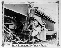 0623547 © Granger - Historical Picture ArchiveTHE TIMBER QUEEN, 1922.   Lobby card showing Ruth Roland in a scene from 'The Timber Queen' episode 11 'The Runaway Engine,' in which Vance, played by Frank Lackteen, attempts to kick her off the train. Lithograph, 1922.
