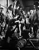 0041973 © Granger - Historical Picture ArchiveWEST SIDE STORY, 1961.   Russ Tamblyn atop George Chakiris as Richard Beymer tries to pull the two apart.