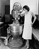 0092574 © Granger - Historical Picture ArchiveCOOKING: CANDY MAKING.   Actress Raquel Torres (1908-1987), making fudge during a visit to a candy factory, early 20th century.