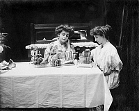 0175767 © Granger - Historical Picture ArchiveELECTRIC COOKWARE, 1908.   Two women seated at a breakfast table, using (left to right) an electric coffee pot, egg boiler, and toaster, all manufactured by General Electric. Photographed in 1908.