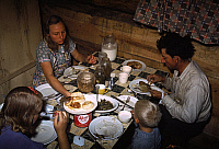 0267376 © Granger - Historical Picture ArchiveNEW MEXICO: DINNER, 1940.   The Faro Caudill family eating dinner in their dugout in Pie Town, New Mexico. Photograph by Russell Lee, 1940.