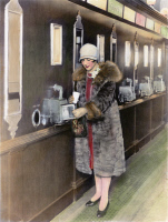 0077212 © Granger - Historical Picture ArchiveAMERICA: AUTOMAT, c1925.   A young woman getting a beverage from an automatic dispensing machine at an 'automat' restaurant. Oil over a photograph, c1925.