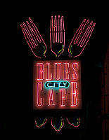 0127438 © Granger - Historical Picture ArchiveNEON CAFE SIGN, 2008.   Blues City Cafe neon sign on Beale Street in Memphis, Tennessee. Photograph by Carol M. Highsmith, October 2008.