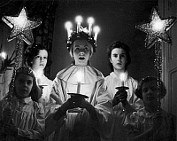 0041886 © Granger - Historical Picture ArchiveST. LUCIA DAY.   Choir of Swedish girls singing carols on St. Lucia Day, which is celebrated on December 13th.