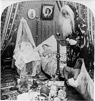 0131182 © Granger - Historical Picture ArchiveCHRISTMAS EVE, c1897.   A studio photograph of Santa Claus with a sack of toys in a bedroom while a woman is sleeping in bed with a baby in a cradle on Christmas Eve. Stereograph, c1897.