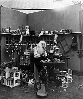 0131184 © Granger - Historical Picture ArchiveCHRISTMAS EVE, c1906.   A studio photograph of Santa Claus in his workshop speaking on a telephone and surrounded by toys. Stereograph, c1906.