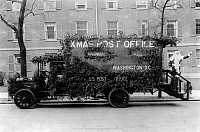 0131185 © Granger - Historical Picture ArchiveSANTA CLAUS, 1921.   A truck decorated in an appeal for early mailing during the Christmas season, with a man dressed as Santa Claus on back of truck in Washington, D.C. Photograph, 10 December 1921.