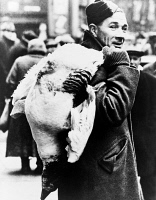 0621662 © Granger - Historical Picture ArchiveLONDON: CHRISTMAS GOOSE.   A soldier in London carrying a goose. Photograph, 7 January 1941.