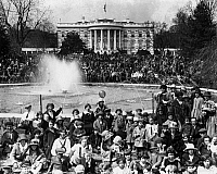 0173392 © Granger - Historical Picture ArchiveWHITE HOUSE: EASTER, c1925.   Families at the annual Easter Egg Roll at the White House lawn in Washington, D.C. Photograph, c1925.
