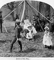 0116118 © Granger - Historical Picture ArchiveMAY DAY FESTIVAL, c1891.   'Queen of the May.' Children playing around a maypole during an American May Day festival. Stereograph, c1891.