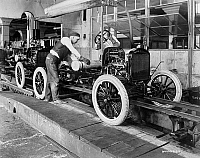0122342 © Granger - Historical Picture ArchiveAUTOMOBILE FACTORY, c1923.   Assembly line workers at an American automobile factory, c1923.