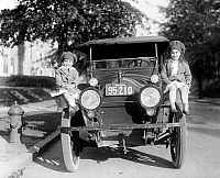 0164141 © Granger - Historical Picture ArchiveGIRLS WITH CAR, c1919.   Two young American girls seated on a car, c1919.