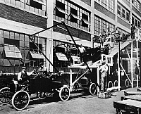 0259835 © Granger - Historical Picture ArchiveFORD ASSEMBLY LINE, 1913.   The last stage of the Model T assembly line at the Ford automobile plant in Highland Park, Michigan. Photograph, 1913.