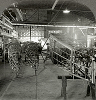 0091867 © Granger - Historical Picture ArchiveAIRPLANE FACTORY, 1927.   Assembly of airplane fuselages at a factory in Wichita, Kansas. 1927 stereograph.