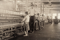 0107421 © Granger - Historical Picture ArchiveMISSISSIPPI: YARN MILL.   A young spinner at a yarn mill in Yazoo City, Mississippi. Photograph by Lewis Hine, May 1911.