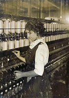 0107429 © Granger - Historical Picture ArchiveTEXTILE MILL, 1916.   Young spinner at the American Linen Company factory, Fall River, Massachusetts. Photographed by Lewis Hine, June 1916.