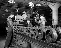 0117990 © Granger - Historical Picture ArchiveHALF-TRACK FACTORY, 1941.   Men working on an assembly line to manufacture U.S. Army half-track scout cars in a converted truck plant in Ohio, during World War II. Photograph by Alfred Palmer, December 1941.
