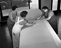 0117991 © Granger - Historical Picture ArchiveAIRPLANE MANUFACTURE, 1942.   Three women sewing fabric on the wing of an airplane in De Land, Florida, during World War II. Photograph by Howard Hollem, 1942.