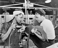 0117996 © Granger - Historical Picture ArchiveDOUGLAS AIRCRAFT FACTORY.   Two women at work at the Douglas Aircraft Company factory in California, during World War II.