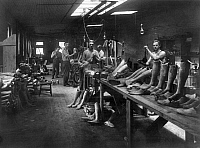 0118009 © Granger - Historical Picture ArchiveARTIFICIAL LIMB MANUFACTURE.   Men at work making artificial legs at the J.E. Hangar shop in Washington, D.C. Photograph, c1916.