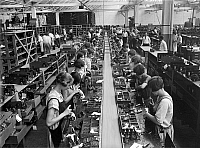 0122366 © Granger - Historical Picture ArchiveRADIO FACTORY, c1925.   Young women at work in the assembly room of the Atwater Kent radio factory in Philadelphia, Pennsylvania. Photographed c1925.