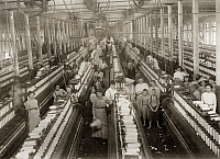 0166704 © Granger - Historical Picture ArchiveHINE: TEXTILE MILL, 1911.   Interior of the Magnolia Cotton Mill spinning room in Magnolia, Mississippi. Photograph by Lewis Hine, March 1911.