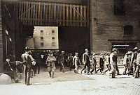 0124304 © Granger - Historical Picture ArchiveHINE: MEAT PACKING, c1908.   Workers, some of them young boys, leaving the Indianapolis Meat Packing House at noon time, Indianapolis, Indiana. Photograph by Lewis Hine, August c1908.