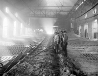 0623168 © Granger - Historical Picture ArchiveIRON CASTING, c1895.   Workers casting pig iron at the Iroquois smelter in Chicago, Illinois. Photograph, c1895.