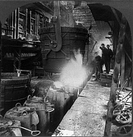 0108666 © Granger - Historical Picture ArchiveSTEEL MILL, c1905.   A ladle pouring molten steel into molds at a foundry in Pittsburgh, Pennsylvania. Stereograph, c1905.