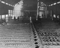 0131275 © Granger - Historical Picture ArchiveALABAMA: SLOSS FURNACE.   Casting pig iron, or crude iron, at the Sloss Furnace in Birmingham, Alabama. Photograph, c1906.