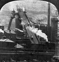 0167228 © Granger - Historical Picture ArchiveSTEEL MILL: BLAST FURNACE.   Blast furnace plant at a steel mill in Pittsburgh, Pennsylvania. Stereograph, c1905.