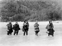 0006310 © Granger - Historical Picture ArchiveGOLD RUSH, 1897.   'Actresses' fording the Dyea River on their way to the Klondike gold fields in 1897.