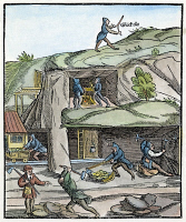 0066652 © Granger - Historical Picture ArchiveMINING, 16th CENTURY.   Mining in 16th century Europe; one worker is trying his luck with a divining rod. Woodcut from a 1580 edition of Georgius Agricola's 'De Re Metallica,' first printed at Basle in 1556.