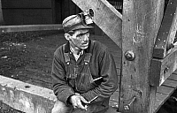 0107766 © Granger - Historical Picture ArchiveCOAL MINER, 1935.   Kentucky coal miner taking a smoking break, Jenkins, Kentucky. Photograph by Ben Shahn, October 1935.