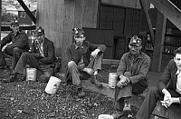 0107768 © Granger - Historical Picture ArchiveCOAL MINERS, 1935.   Kentucky coal miners taking a work break, Jenkins, Kentucky. Photograph by Ben Shahn, October 1935.